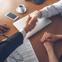 new property owner shaking hands with mortgage broker